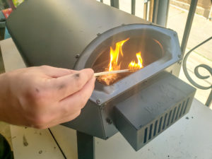 How to light fire in pizza oven