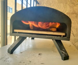 Wood fired pizza oven, roaring flames, bartello pizza oven