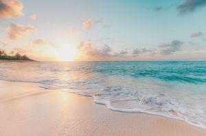 beautiful beach setting, colorful sunset