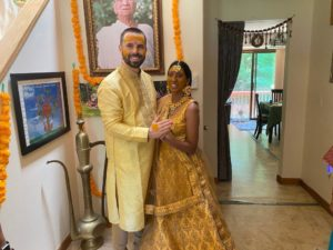 Interracial couple during pithi/haldi ceremony